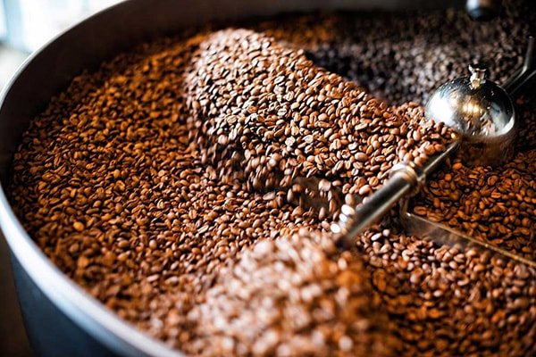 A larger photo of coffee beans roasting in a roaster, Self-Service Micro Markets