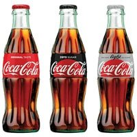 Three coca cola bottles