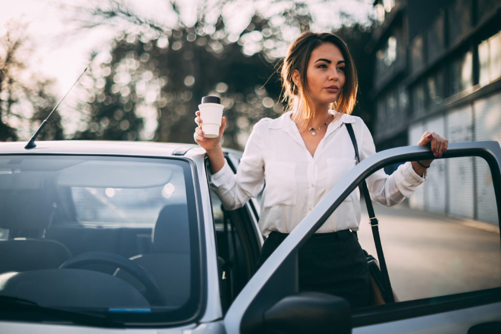 employee driving to pick up coffee